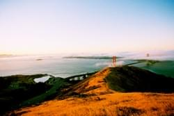 Golden Gate Bridge and gold hills at sunrise