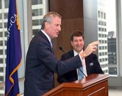 Being introduced by Mayor de Blasio