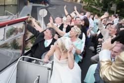 Celebrating after the wedding on a double decker bus in las vegas