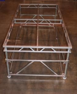 Box Suspension supporting a 4'x8' platform with clear acrylic
