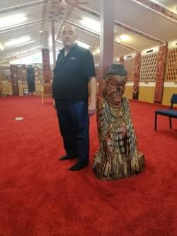 Mr Steve Bethell with the poutokomanawa that represents Maj Gen Poananga