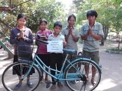 Bike donated by the Mark & Trina Ramsey Foundation so that the Cambodian children pictured can attend school