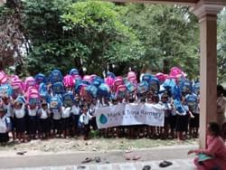 Cambodian School Children with Backpacks containing school supplies donated by the Mark & Trina Ramsey Foundation