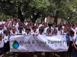 Mandatory School Uniforms donated by the Mark & Trina Ramsey Foundation to enable these Cambodian children to attend school this fall