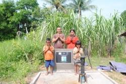 The  Khon family of Cambodia expresses gratitude for the water well donated by the Mark & Trina Ramsey Foundation