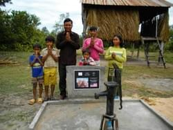 A grateful Cambodian family expresses gratitude to MTRF for a well dedicated to Bill & Molly Hoffman of Maui