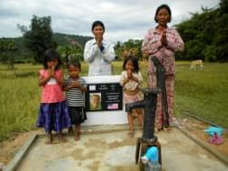 A water well shown with the Cambodian family that received it.  This was donated by MTRF in memory of our dear friend Todd Hokanson's mom, Judy