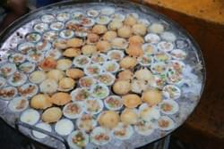 Mote Lin M-ya (Couple snack) It is made with rice flour, sprinkled with brown beans and spring onions each individually and combined after they are cooked.