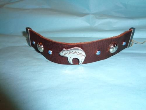 Brown leather bracelet with bear concho.
