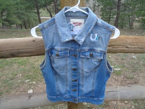 Size small denim vest with custom embroidery.