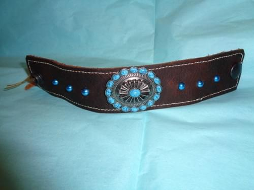 Brown leather bracelet with turquoise concho.