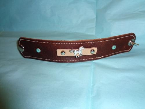 Brown leather bracelet with ss running horse.