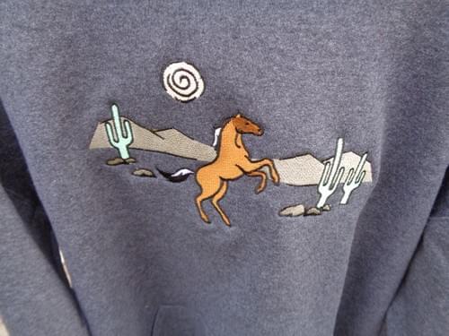Women's Large sweatshirt with custom embroidery.