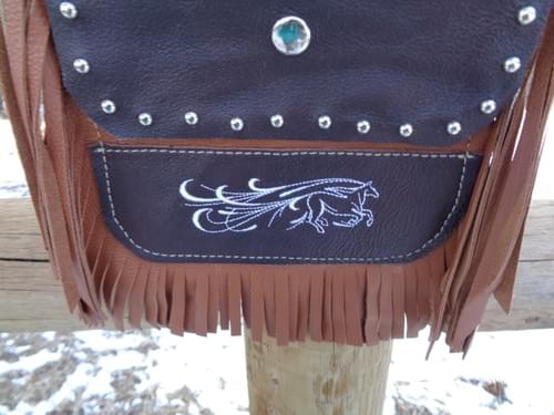 Caramel and dark brown hip bag with flowing horse.
