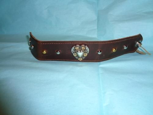 Brown leather bracelet with heart concho.