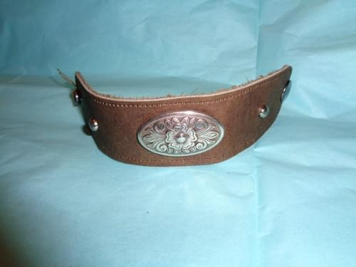 Brown leather bracelet with flower concho.