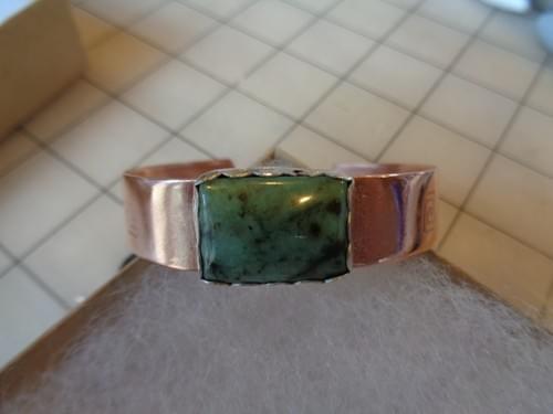 Copper bracelet.