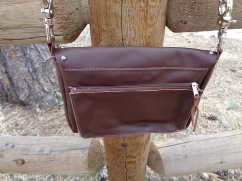 Brown hip/shoulder bag with embroidered flowing horse.