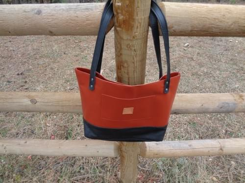 Medium leather tote bag with embroidered horse.