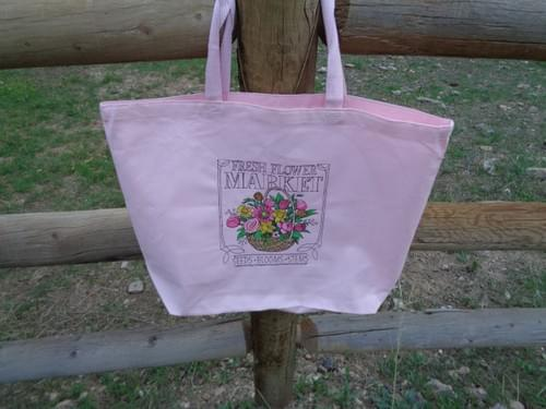 Large pink canvas tote bag.