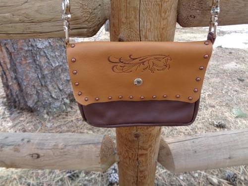 Brown/Caramel Hip/Shoulder bag with flowing horse.