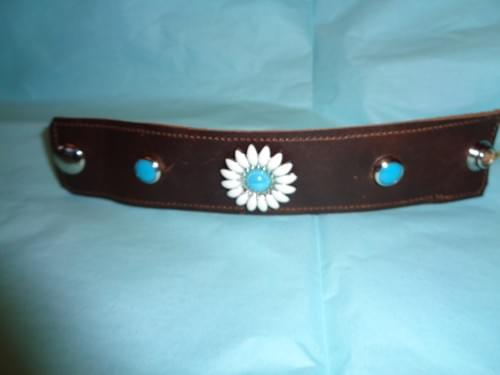 Brown leather bracelet with daisy concho.