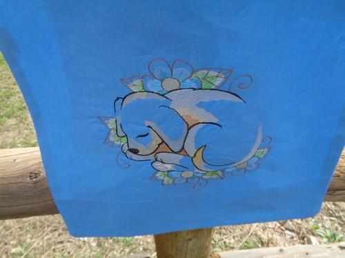 Light blue canvas tote with sleeping puppy.