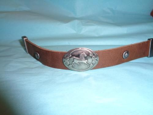 Brown leather bracelet with horse concho.
