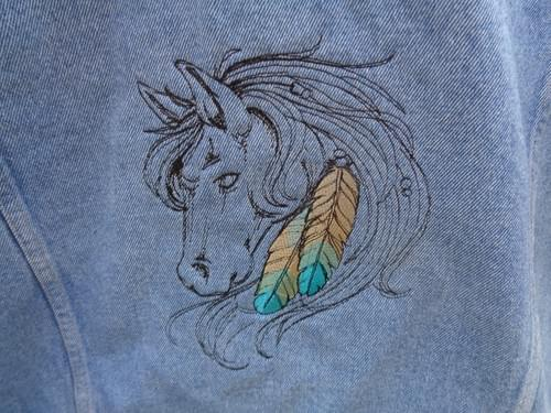 Women's size Lg jean jacket with embroidered horse.