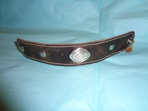 Brown leather bracelet with southwest concho.