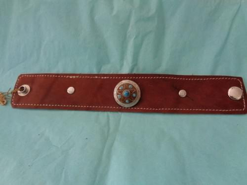 Brown leather bracelet with concho.