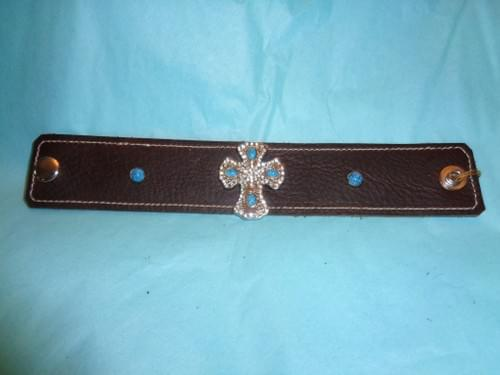 Dark brown leather bracket with turquoise cross concho.