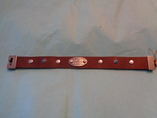 Brown leathe bracelet with turquoise rivets.