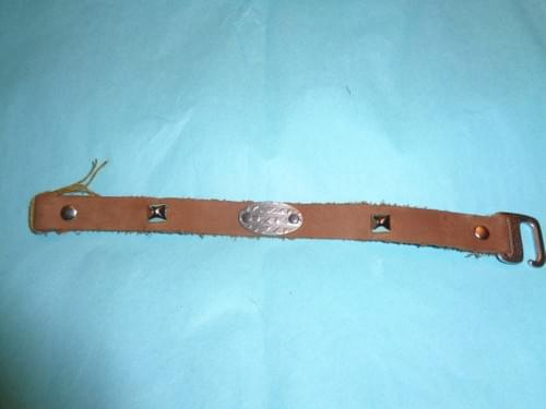 Brown leather bracelet with pyramid spots.