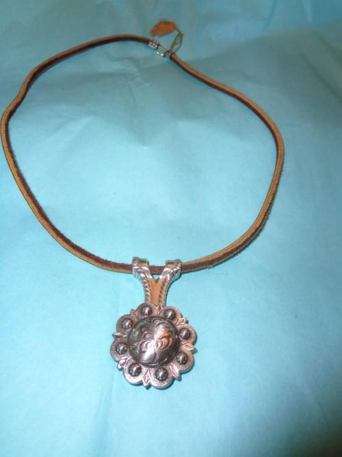 Brown leather necklace with berry concho.