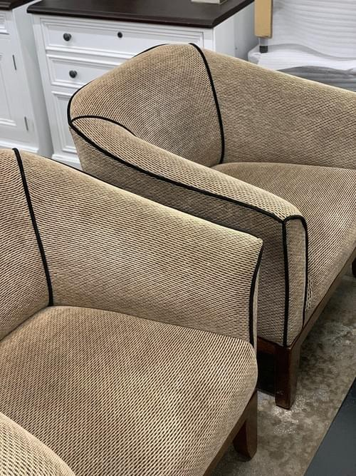 Pair of Tan Arm Chairs with Dark Brown Piping