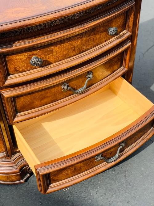 Three Drawer Wood Dresser with Carved Accents