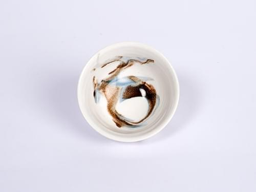 Porcelain teacup with Sinoyaki like pattern