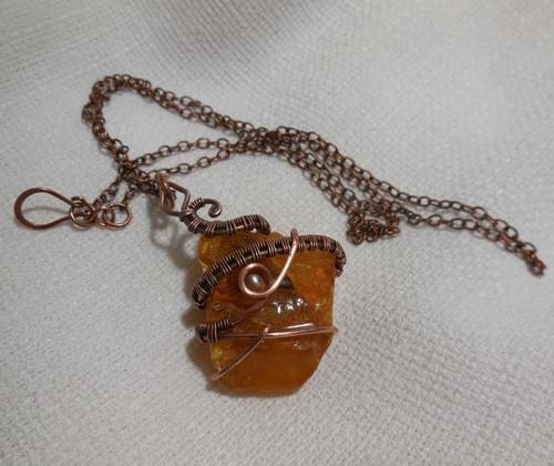 "Amuleto ""Serpente"" in Ambra Baltica e Rame"