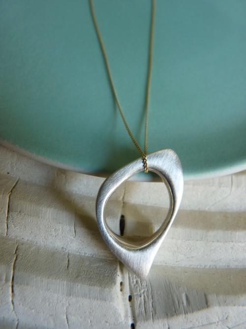 New - Infinity Quirky Oval Pendant hung on 9ct gold chain