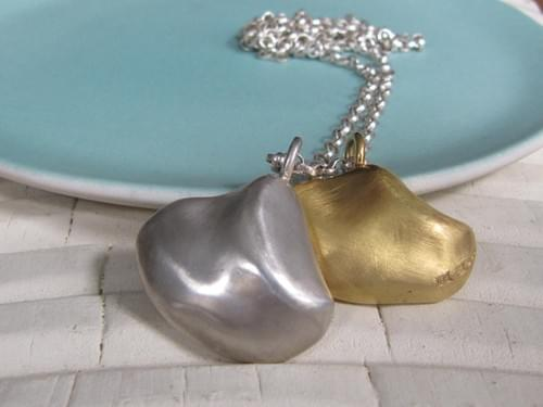 Infinity Double Shell Necklace - Gold and Silver Solid Shells nestled side by side.