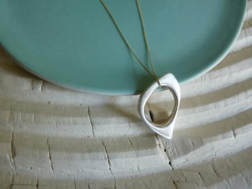 One Quirky Oval Pendant hung on 9ct gold chain