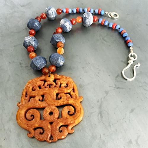 Carved Jade with Blue Coral and Carnelian