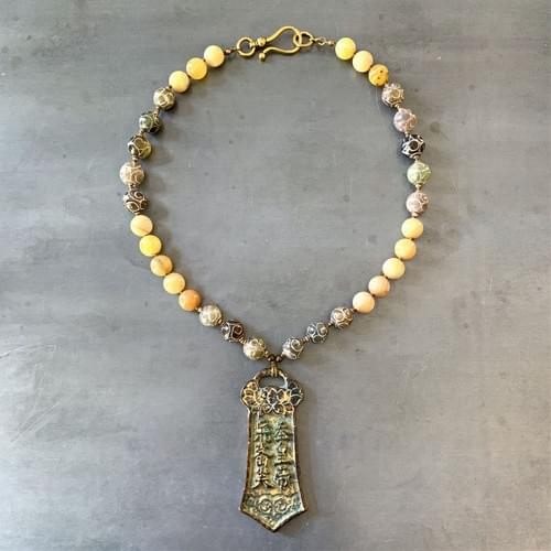 Chinese Spade Money Pendant on Hand-Knotted Jade