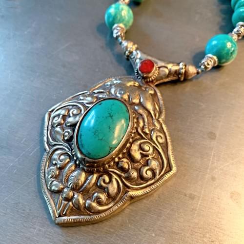 Tibetan Silver Repoussé Pendant and Turquoise