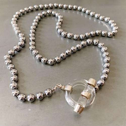 Hematite with a Quartz Crystal and Silver Toggle Strand Necklace