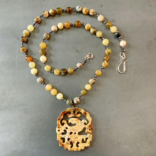 Yellow-Brown Jade with Carved Phoenix Pendant