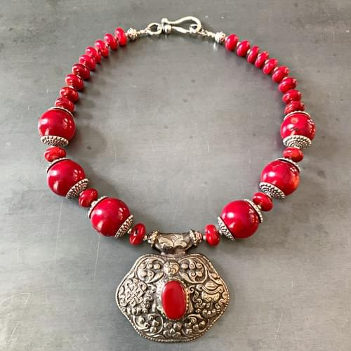 Tibetan Repoussé Pendant and Red Coral Necklace