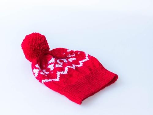 Bonnet à pompon (motifs et coloris variés)
