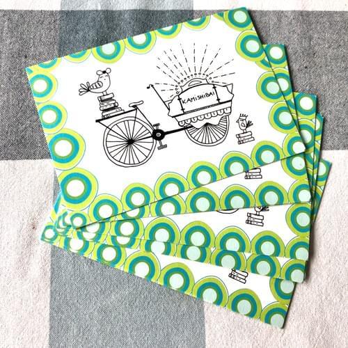 pakket met 8 postkaartjes met tekening van bakfiets vol verhalen